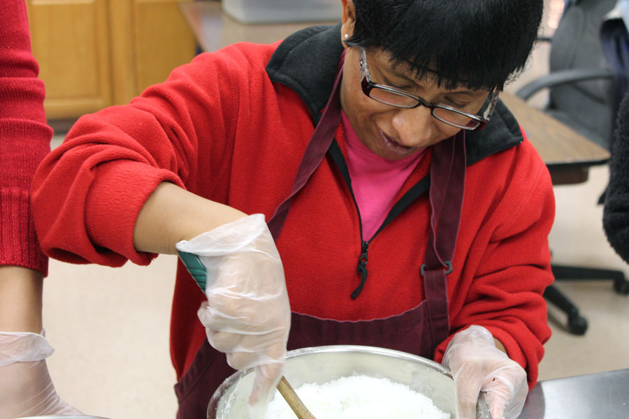 Beverly Farm resident cooking in Busy Bee Bakery