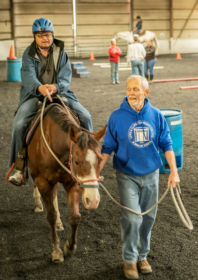 Beverly Farm resident on horse in Equestrian Center