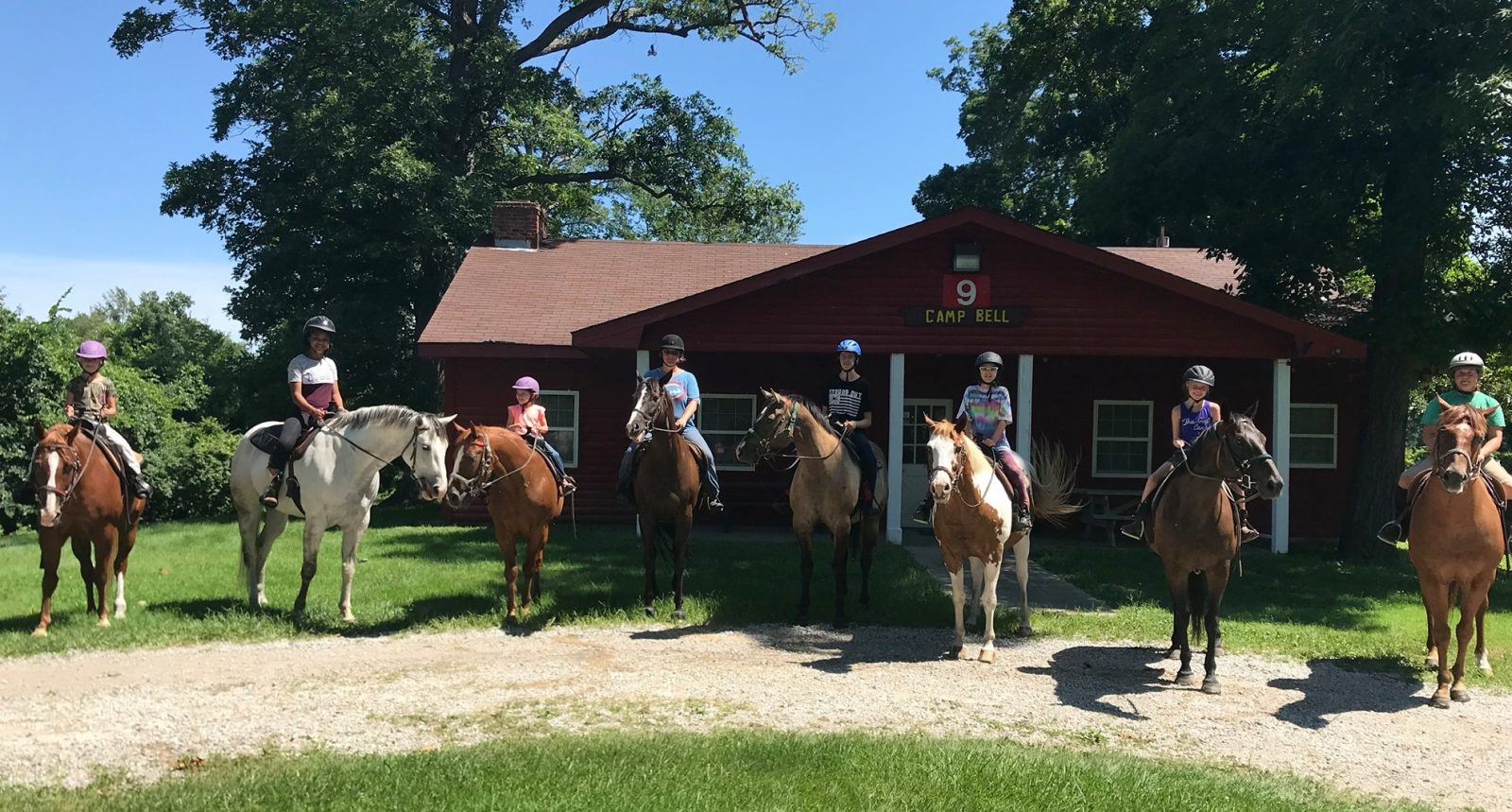 Equestrian Center at Beverly Farm. 8 Trail riders at Camp Bell.