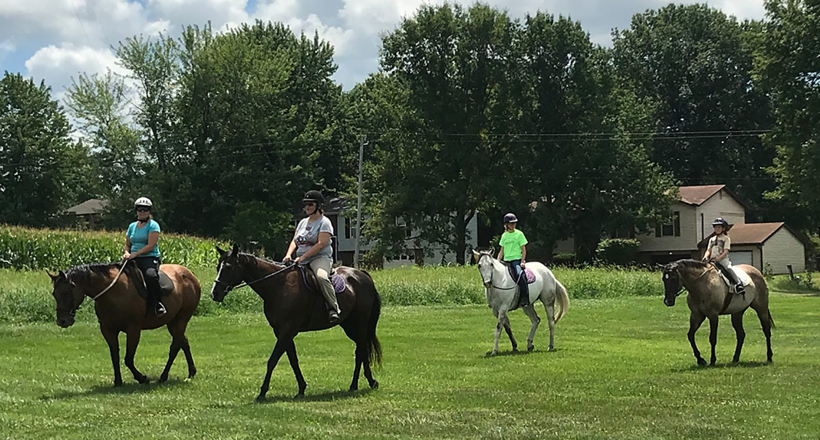Equestrian Center at Beverly Farm. Four trail riders.